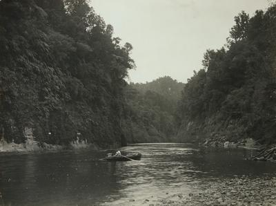 Untitled (river scene, one man rowing a canoe - horizontal format)