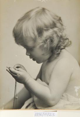 Untitled (portrait of young child with watch)