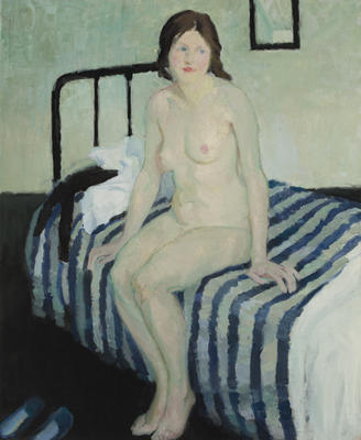 Girl sitting on a bed