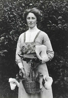 Portrait of Edith Collier with a basket of lilies