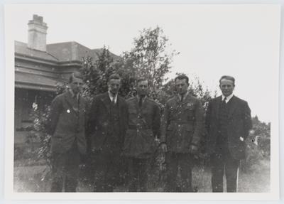 Portrait of five Collier brothers outside.