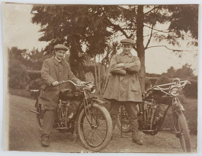 Unknown; Postcard printed with a photograph of two men with motorcycles; Unknown; A2015/1/36