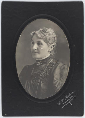 Eliza Collier wearing a dark dress