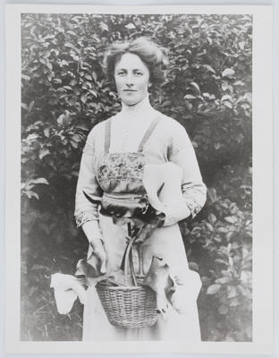 Portrait of Edith Collier holding a baset of lilies (reproduction of original print)