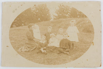 Group portrait outside of Eliza Collier and her young children