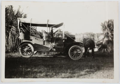 Photograph of Henry Collier beside car.