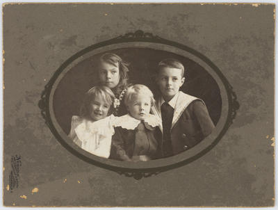 Studio portrait of four Collier children looking right.