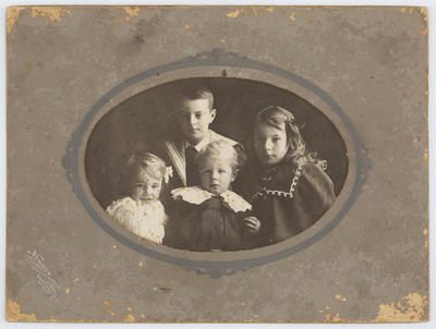 Studio portrait of four Collier children in landscape orientation.