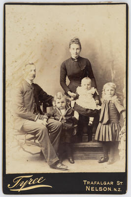 Studio portrait of Henry and Eliza Collier and three of their children.