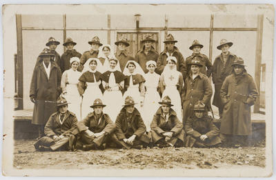 Postcard printed with a photograph of officers and nurses
