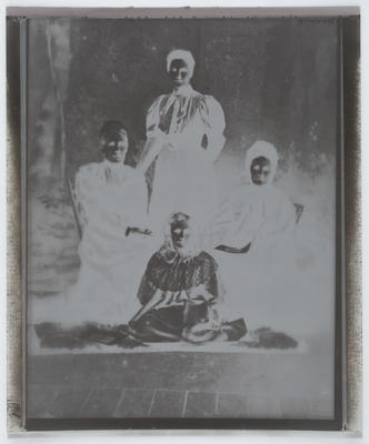 Negative of studio portrait of Edith Collier, her mother and two grandmothers.