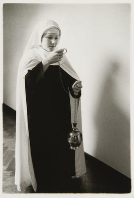 Sister Therese taking the thurifer to the sanctuary. As sacristing she has charge of everyday that belongs to the church.