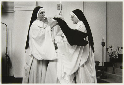 Sister Therese receiving the black veil...Receive this veil which proclaims you have turned aside from the world and its ways and consecrated yourself to the bridegroom Jesus Christ the Son of God