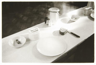 Anne Noble; A place setting in the refectory. The Great Silence is observed here, and meals are accompanied by readings from the Rule of St Benedict or of a religious or historic nature.; 1988; L1991/23/43