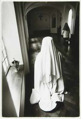 Anne Noble; Sisters in prayer in the cloister before Compline. The stoup and brush are used to bless the community with holy water at the end of the day.; 1988; L1991/23/50