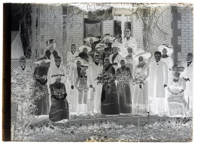 Glass plate negative showing wedding of Frank Denton and Ethel Morley at her father's residence.