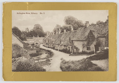 Unknown; Black and white photographic postcard of Arlington Row, Bibury. It shows a row of houses on a small street.; A2015/1/155