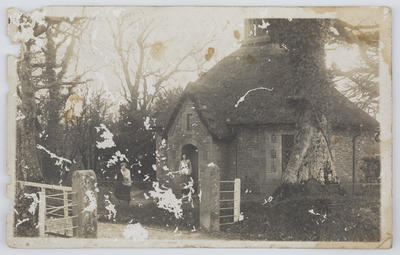 Unknown; Black and white photographic postcard of a stone house and yard.; 24 Dec 1918; A2015/1/156