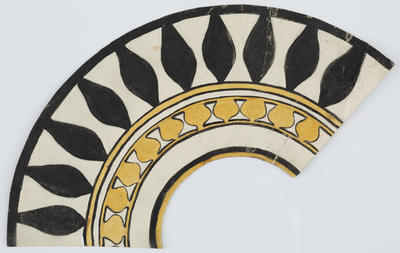Unknown; A circular collar. Decorated with black, yellow and cream repeating curved patterns.; A2015/1/186
