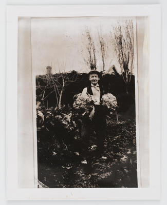 Unknown; Photograph of man holding two cauliflowers; Unknown; A2015/1/472