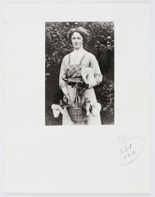 Unknown; Photograph of Edith Collier holding a basket of lillies; 1912; A2015/1/478