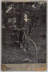 Portrait of Edith Collier aged 13 with a bicycle