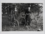 Portrait of Edith Colllier and Ethel M Davis with bicycles