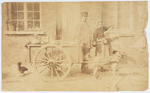 Photograph of a man and woman with a cart.