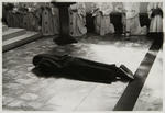 During the ceremony of her Final Profession, a sister lies in front of the alter while the community and the congregation say a litany or prayer of intercession, the the angels and saints...By the life and labour of all monks promote the welfare of all humanity...Hear prayer...etc.